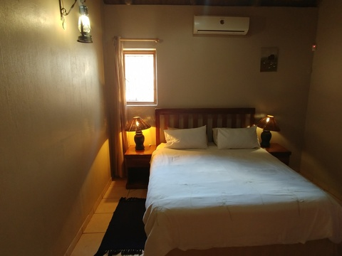 Wild Monkey Tree cottage - en-suite bedroom 1 with aircon