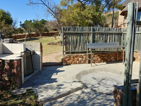 Stone Lodge, private braai, boma and garden at Sky Lodge, Hartbeespoort self catering accommodation