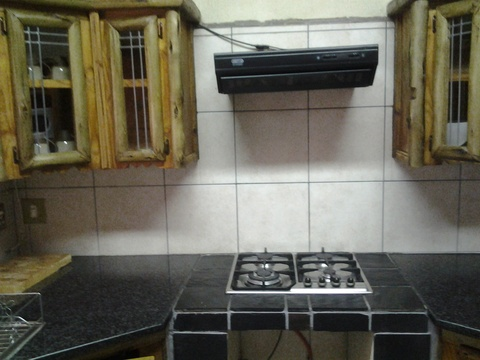 Self-catering kitchen with gas hob, microwave and fridge