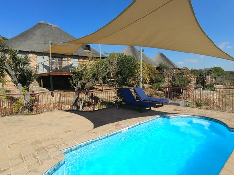 Sky Lodge, Hartbeespoort - View of Wild Monkey Tree cottage and Stone Suites from the pool
