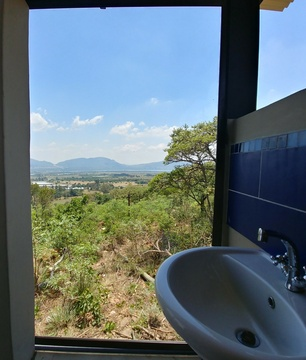 "Sky Lodge, Hartbeespoort - Blue Sky Lodge private pool deck with ""Loo with a View"""