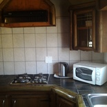 Butterfly cottage self catering kitchen with gas hob, microwave oven and fridge