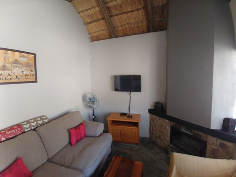 Sky Lodge, Wild Monkey Tree cottage, Hartbeespoort self catering accommodation, lounge and fireplace