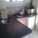 Self catering kitchenette with gas hob, microwave and fridge